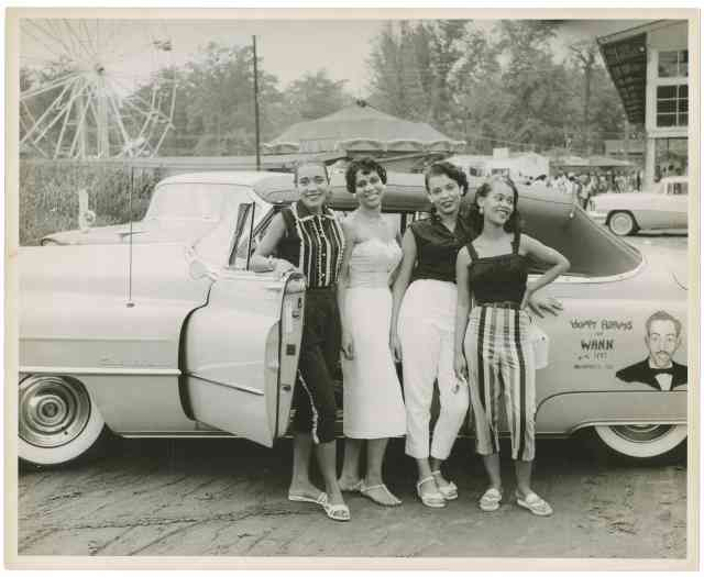 Four young African American women standing beside a convertible automobile, ca. 1958.   Courtesy WANN Radio Station Records, Archives Center, National Museum of American History, Smithsonian Institution.